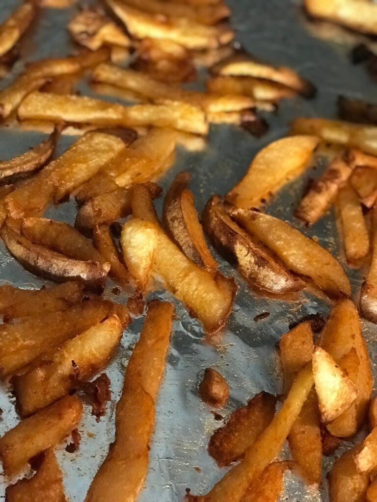 Crispy jicama French fries on a sheet pan