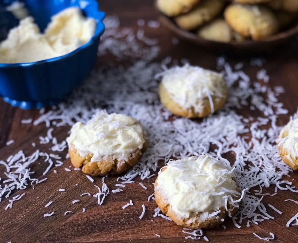 close-up of coconut cookies with shredded coconut around the cookies