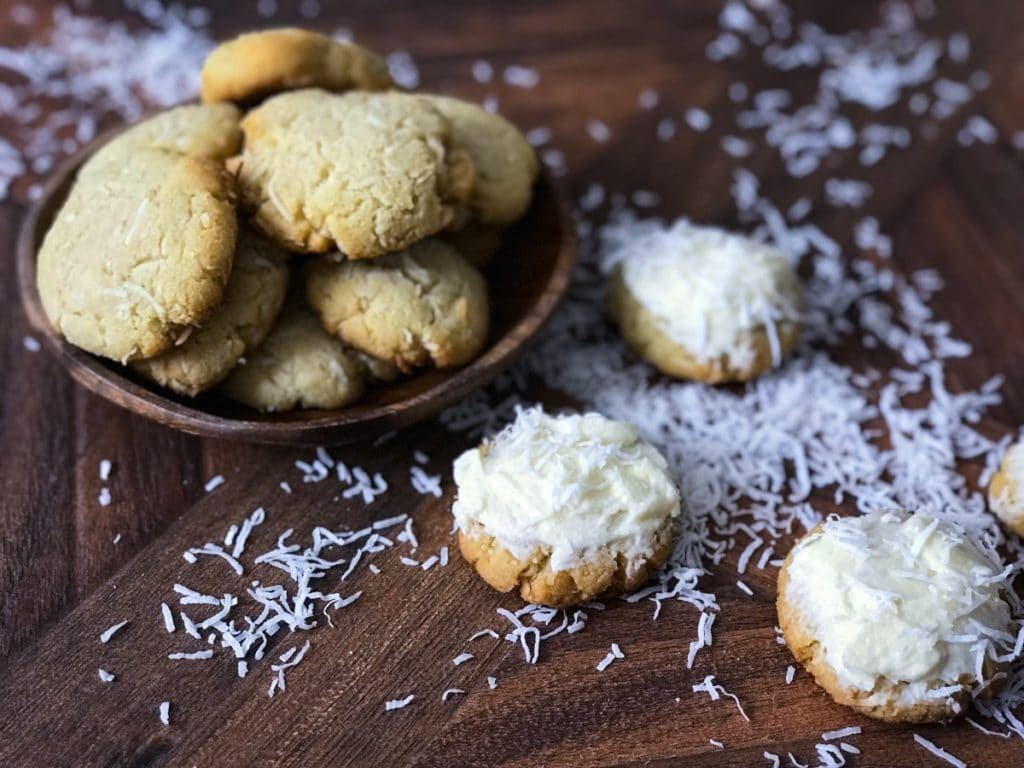 coconut cookies stacked in a plate