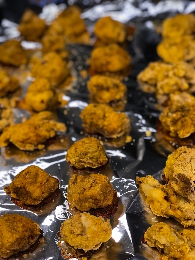 popcorn chicken bites on a baking sheet