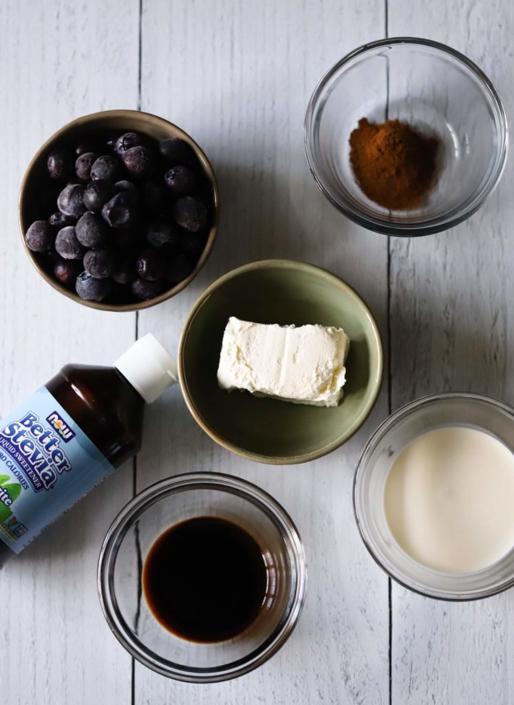 overhead shot of ingredients to make keto blueberry cheesecake smoothie