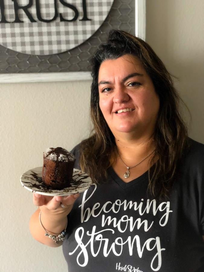 my mom holding the keto mug cake on a plate