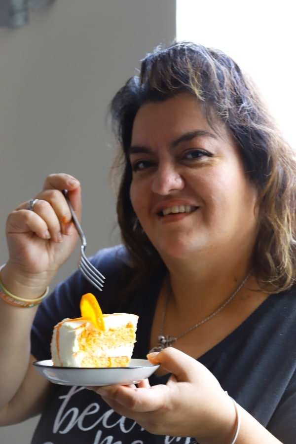 a photo of my mom getting ready to take a bite or the low carb orange creamsicle cake