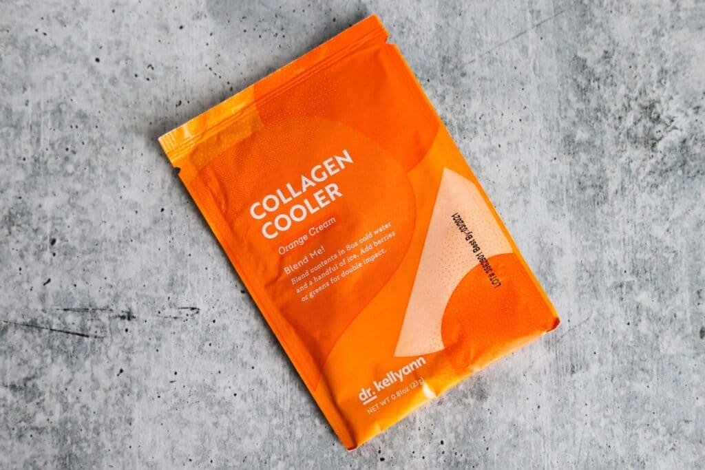 the front side of the orange cream collagen cooler packet