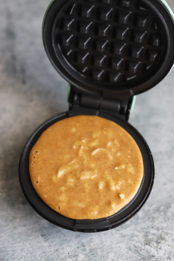 pumpkin chaffle added to the waffle maker griddle