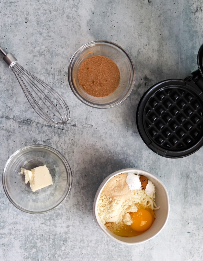top view of all ingredients and tools used to make snickerdoodle chaffles