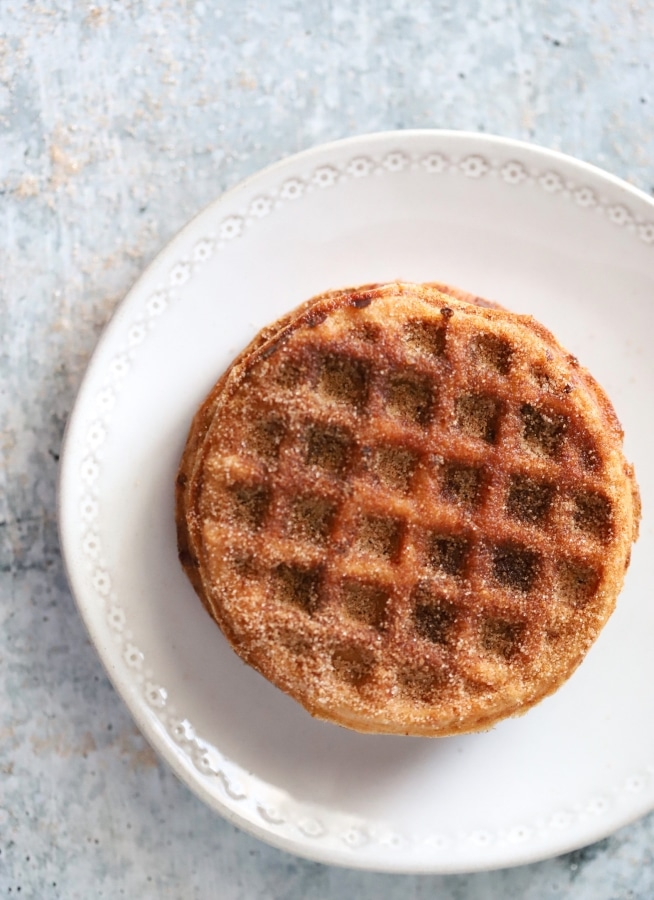 top view of snickerdoodle chaffles on a plate to the side