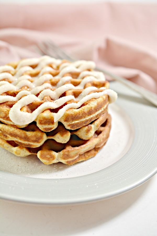 close up side view of stack cinnamon roll chaffles