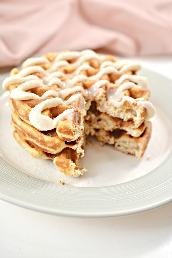 three cinnamon chaffles taken a slice out of