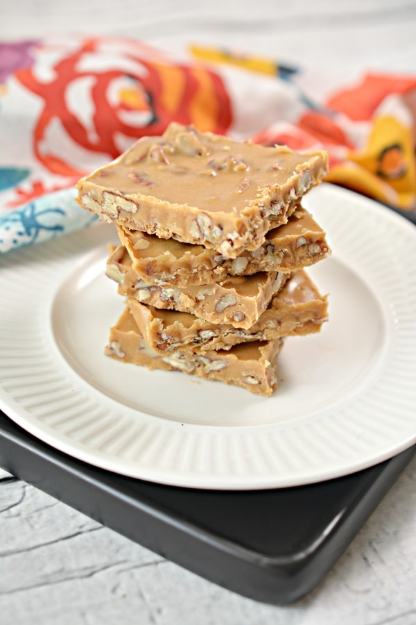 keto peanut pecan bars stacked up on top of each other on a plate