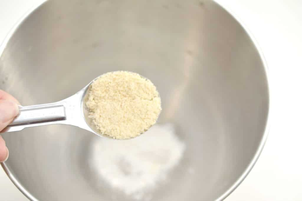 tablespoon of coconut flour over a mixing bowl
