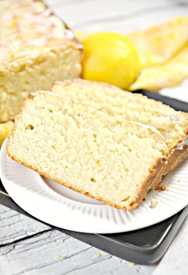 close up of sliced keto lemon pound cake on a plate