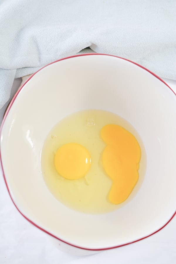 cracked eggs in a mixing bowl