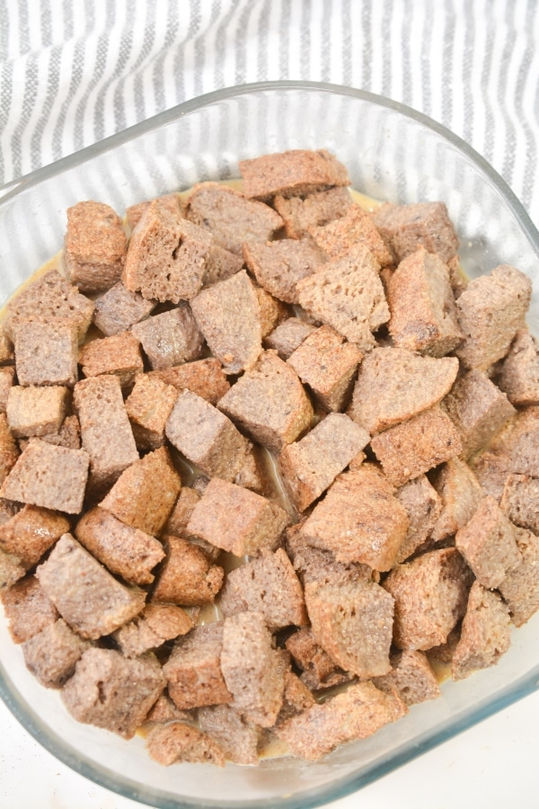 soaked bread cubes in a baking dish