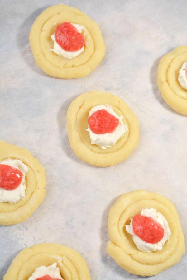 strawberry filling and cream cheese on danish dough
