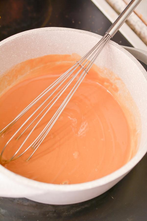 whisking all ingredients in saucepan
