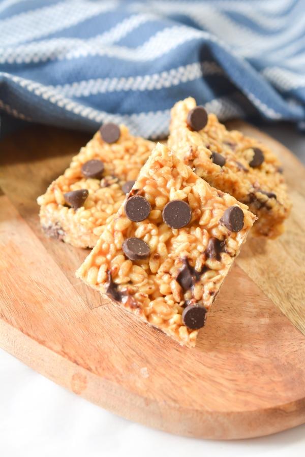 three keto peanut butter Rice Krispie treat on a cutting board